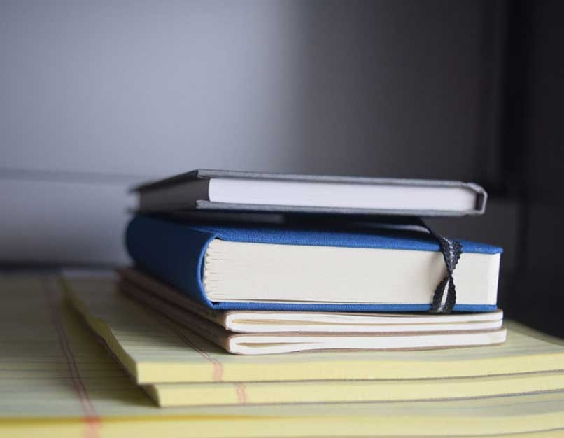 stack of notepads and books