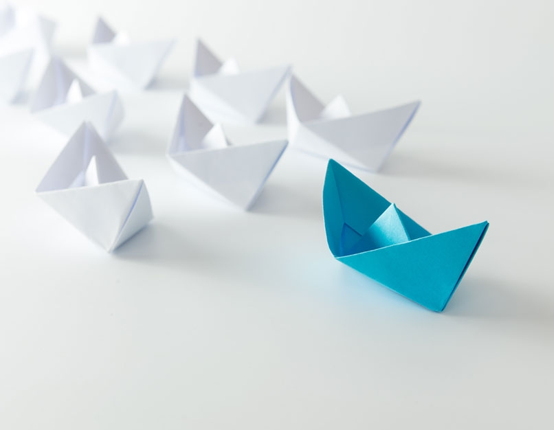 paper boats in formation