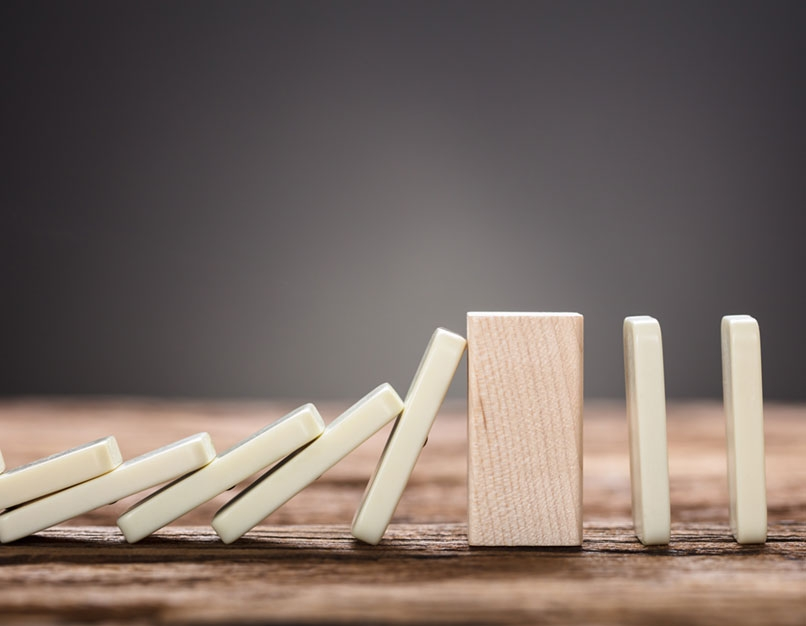 falling dominos with wood block
