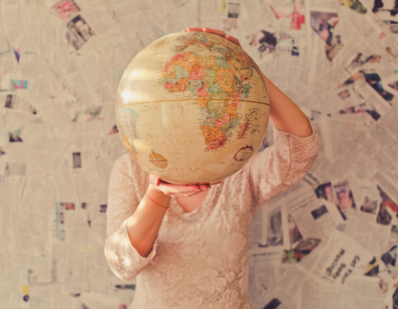 person holidng a globe showing africa