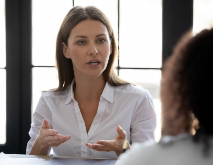 A businesswoman speaks during a meeting